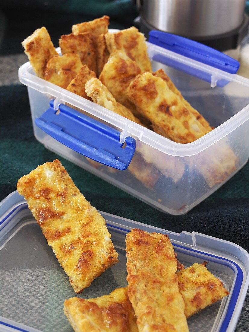 Cheesy bread fingers in food storage box