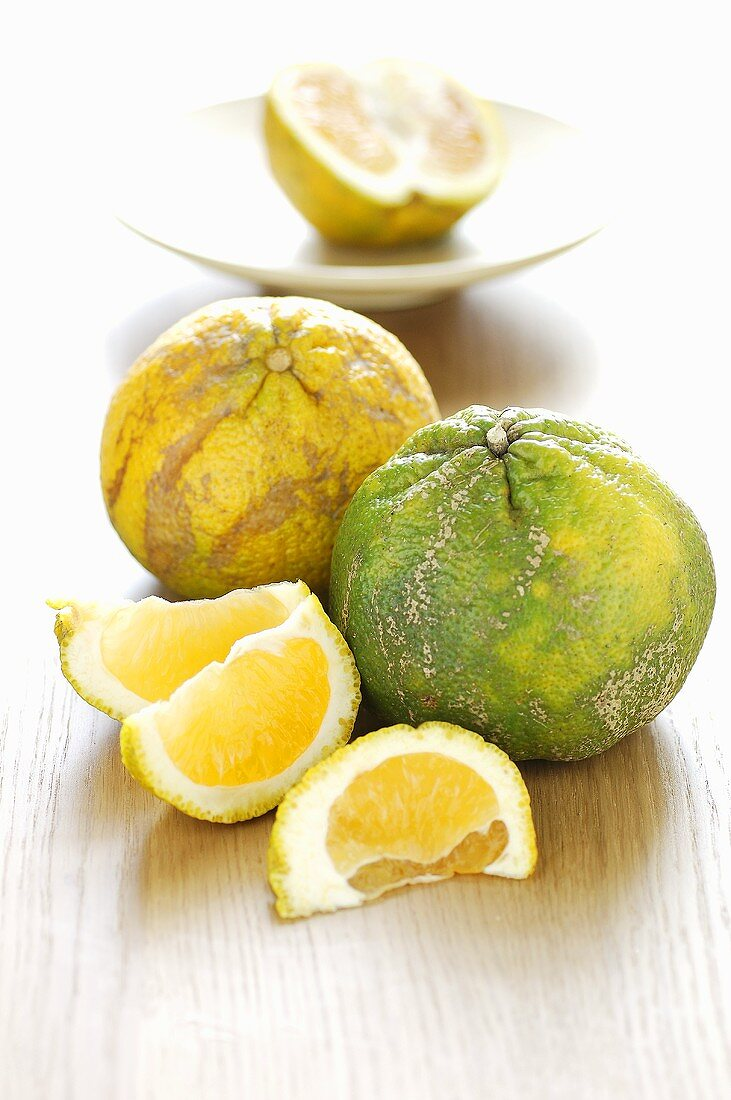 Green and yellow ugli fruit (citrus fruit)