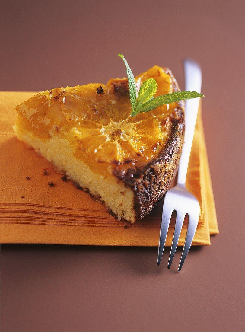 A piece of orange chocolate cake