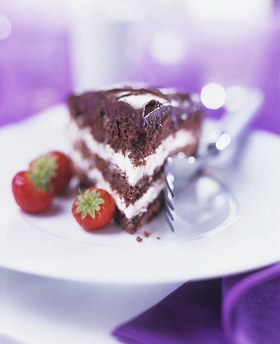 A piece of cream-filled chocolate cake