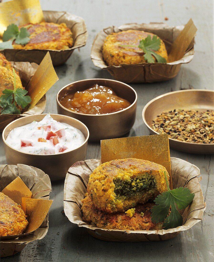 Aloo tikki (Indian potato cakes) with chutney and dip