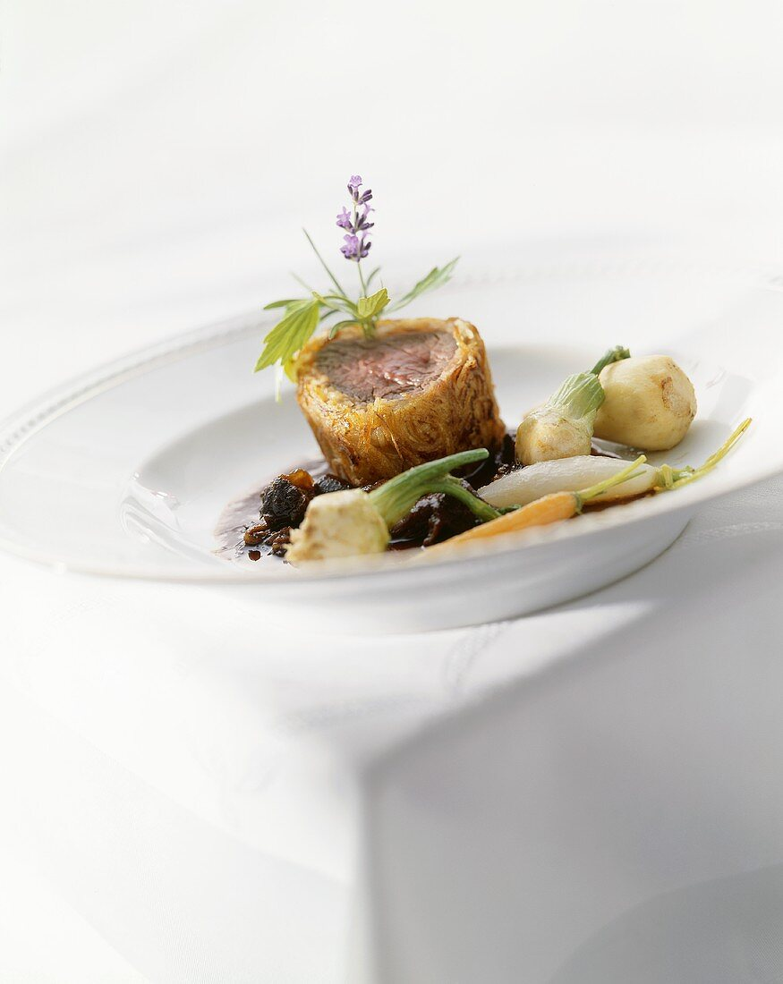 Beef fillet in rösti crust on oxtail ragout with root vegetables