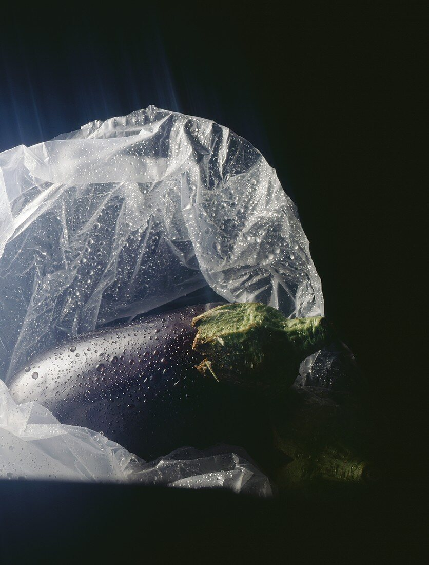 Aubergine with drops of water in a plastic bag