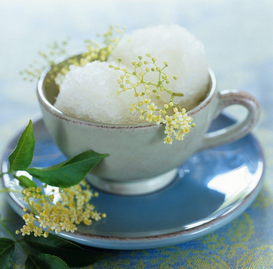 Elderflower sorbet in a cup and saucer