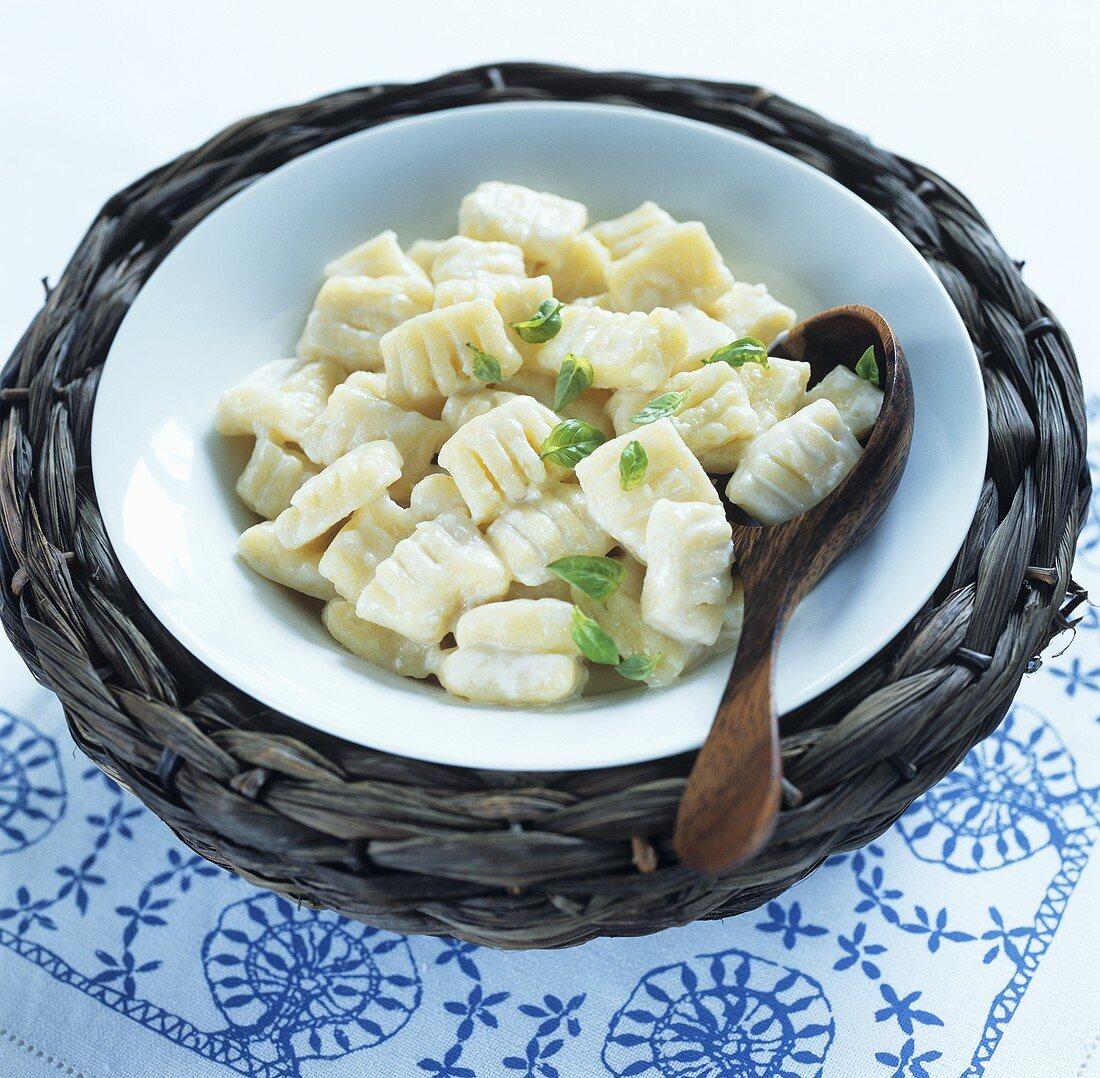Halusky (Slovakian noodles) with basil leaves