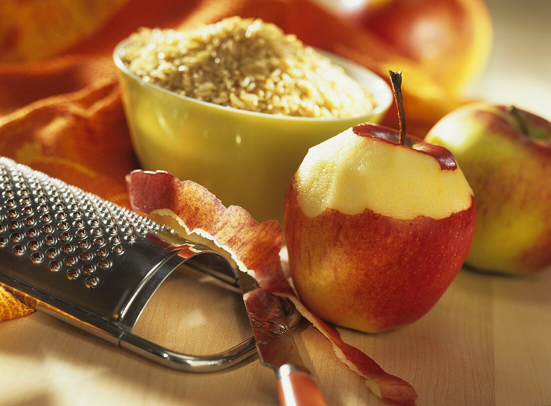 An apple and a bowl of brown rice