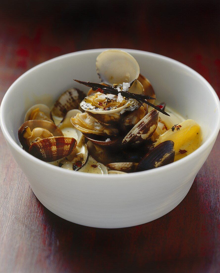 Steamed shellfish in aniseed and ginger stock