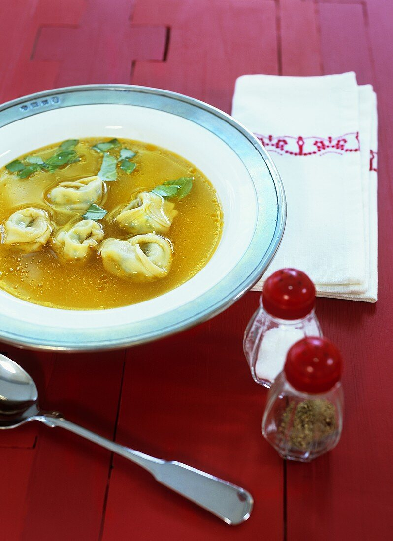 Beef and tomato broth with ricotta tortellini
