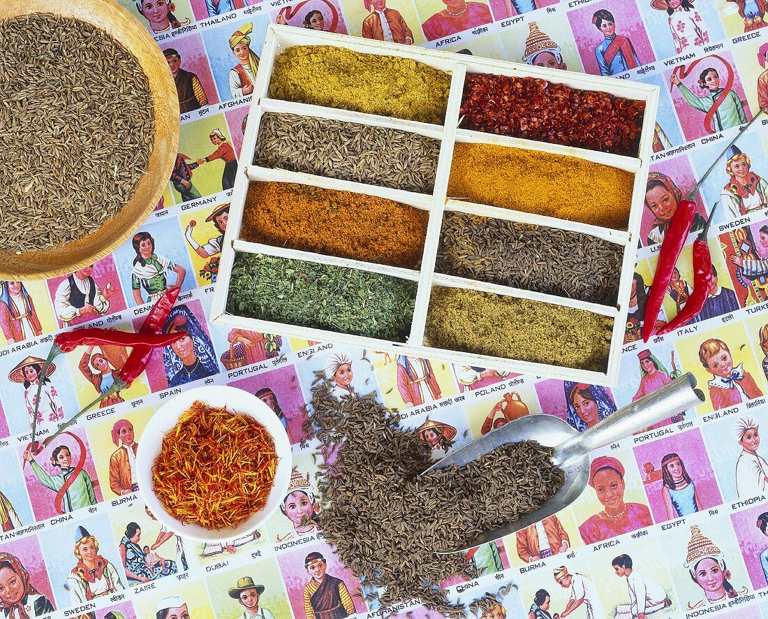 Colourful spices a seed tray with cumin and saffron threads