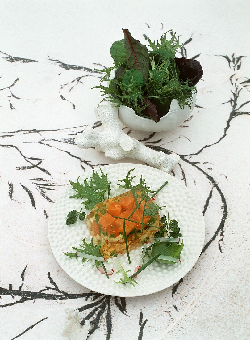Jellied salmon with a wild herb salad