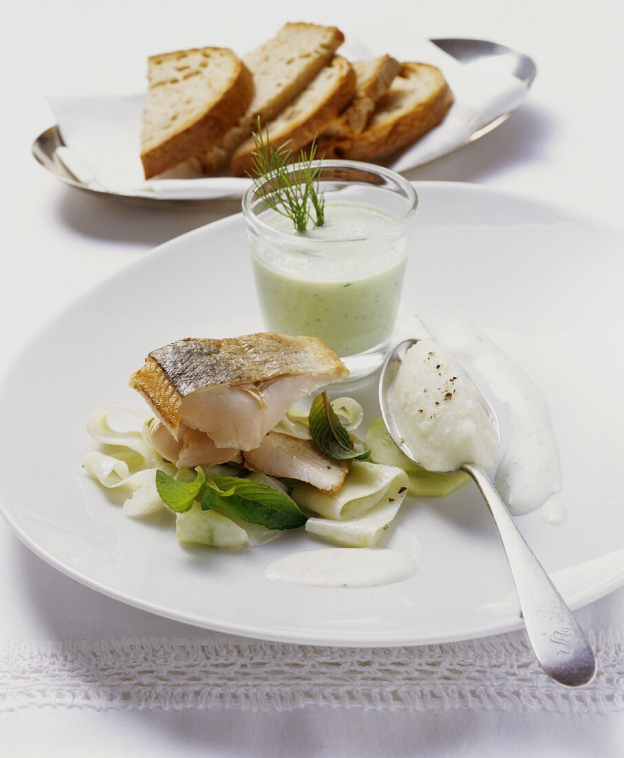 Fried salmon trout with cucumber