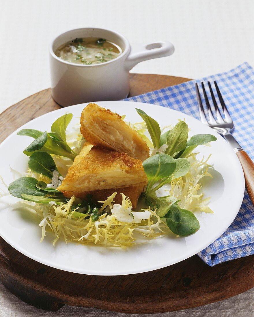 Obazter (Bavarian cheese spread) pasties with onion vinaigrette and a mixed leaf salad