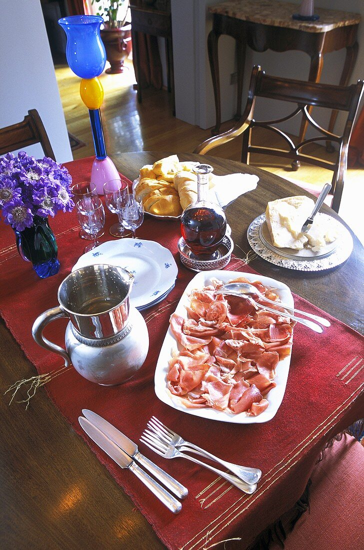Supper on a wooden table with a red table runner