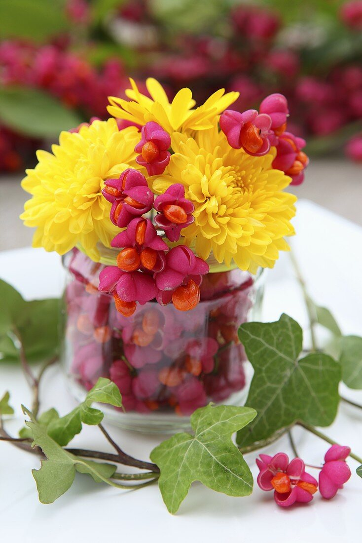 A small bunch of flowers with chrysanthemums and spindle flowers