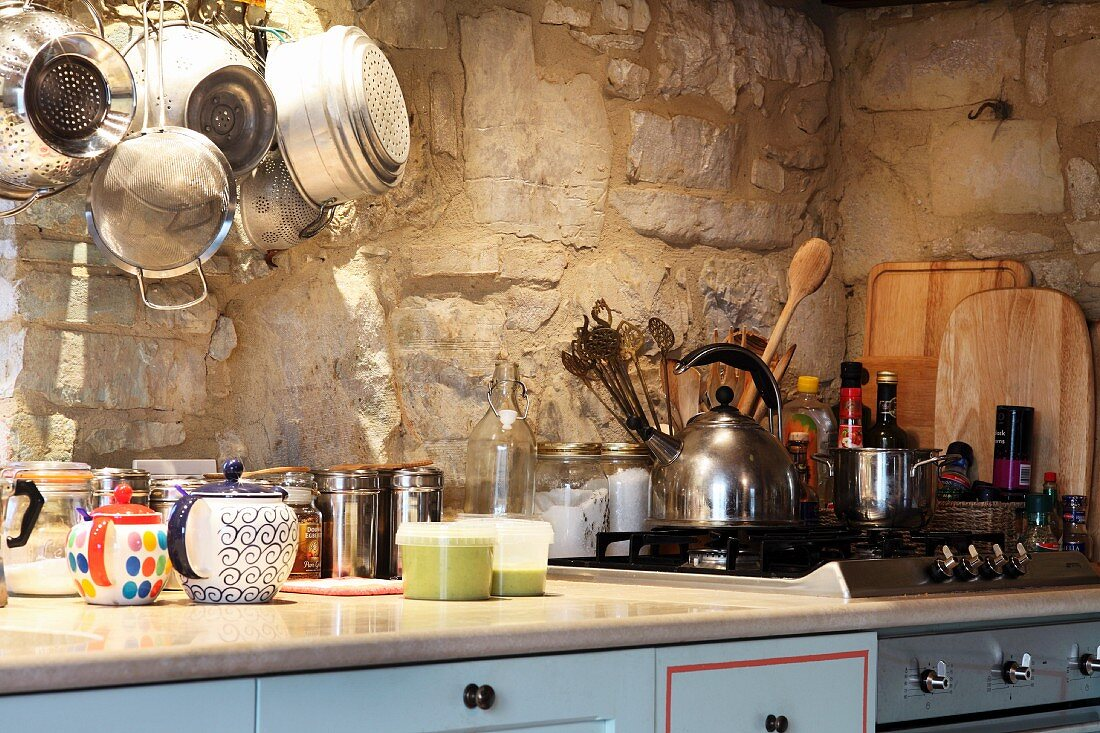 A kitchen in a country house with a gas cooker in Umbria, Italy