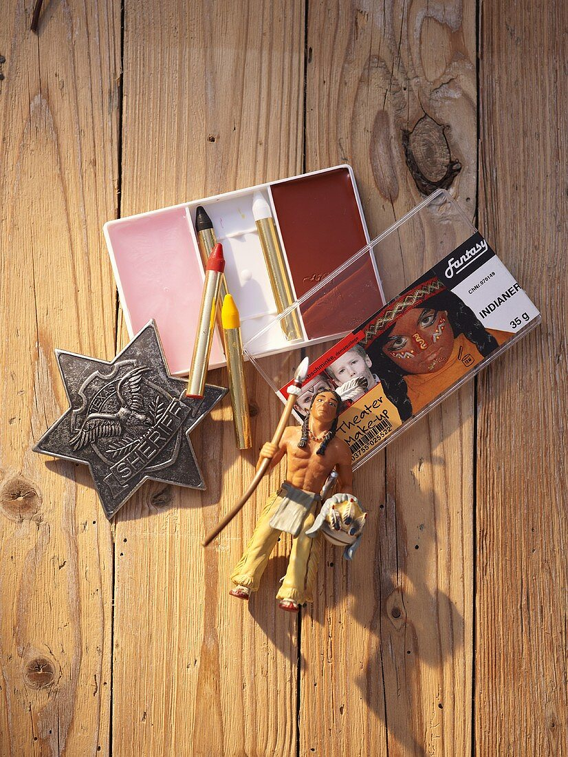 Make-up and a sheriff's star as props for a Western-themed party
