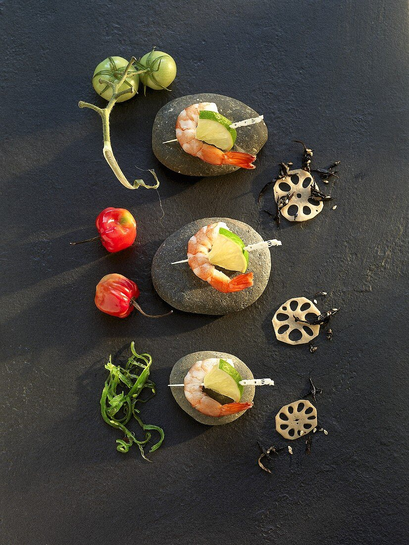 Prawn kebabs with limes, lotus roots, hijiki and seagrass salad