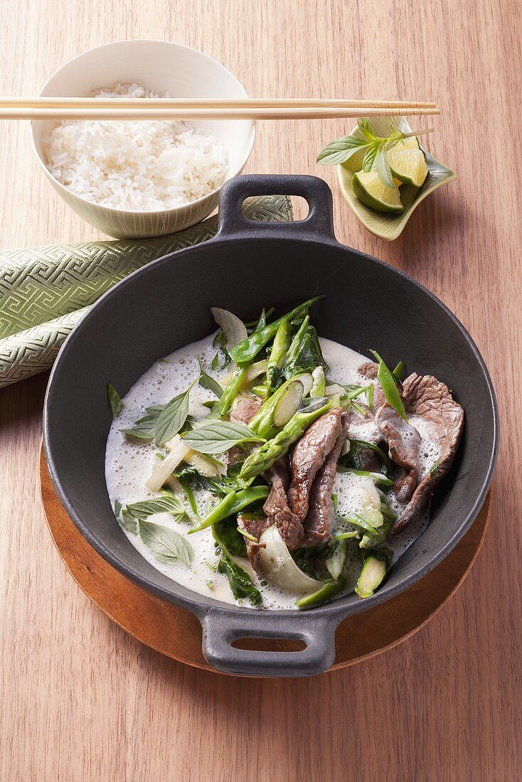 Beef with a green curry and coconut sauce