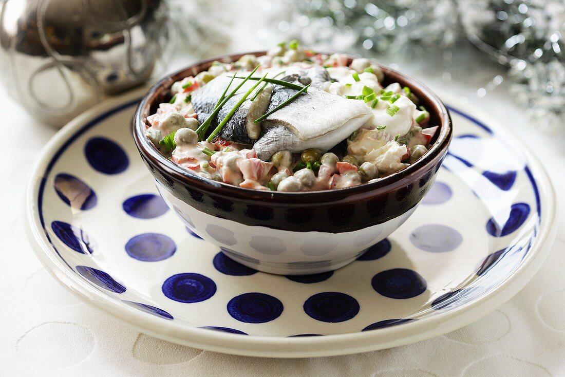 Christmas vegetable salad with herring