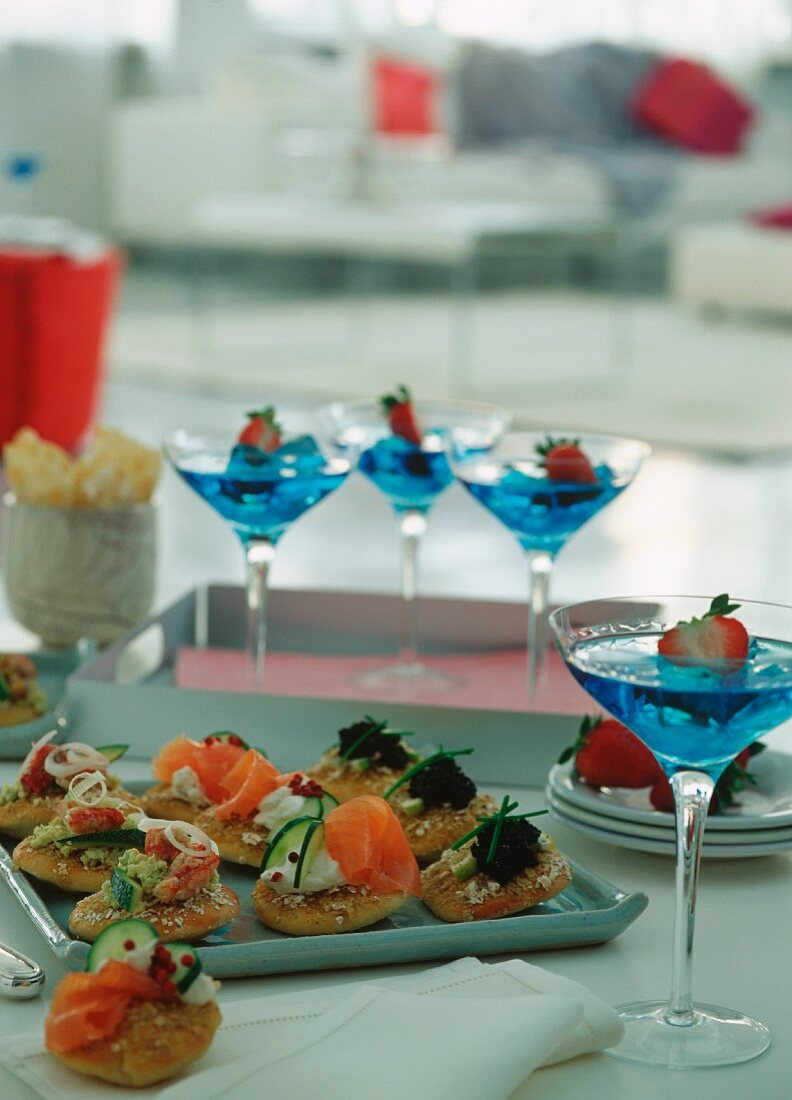 Canapés and deserts on a party buffet