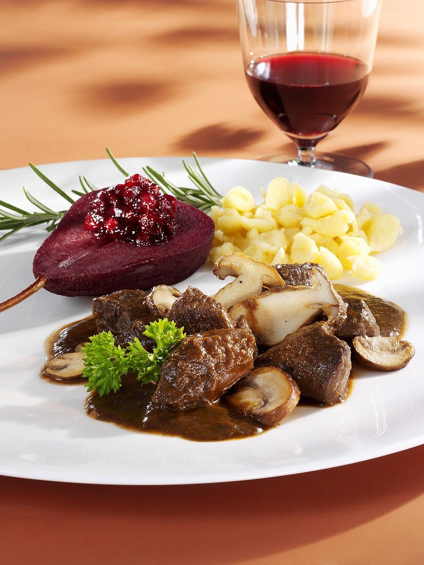 Venison ragout with mushrooms, red wine pear, cranberries, spaetzle
