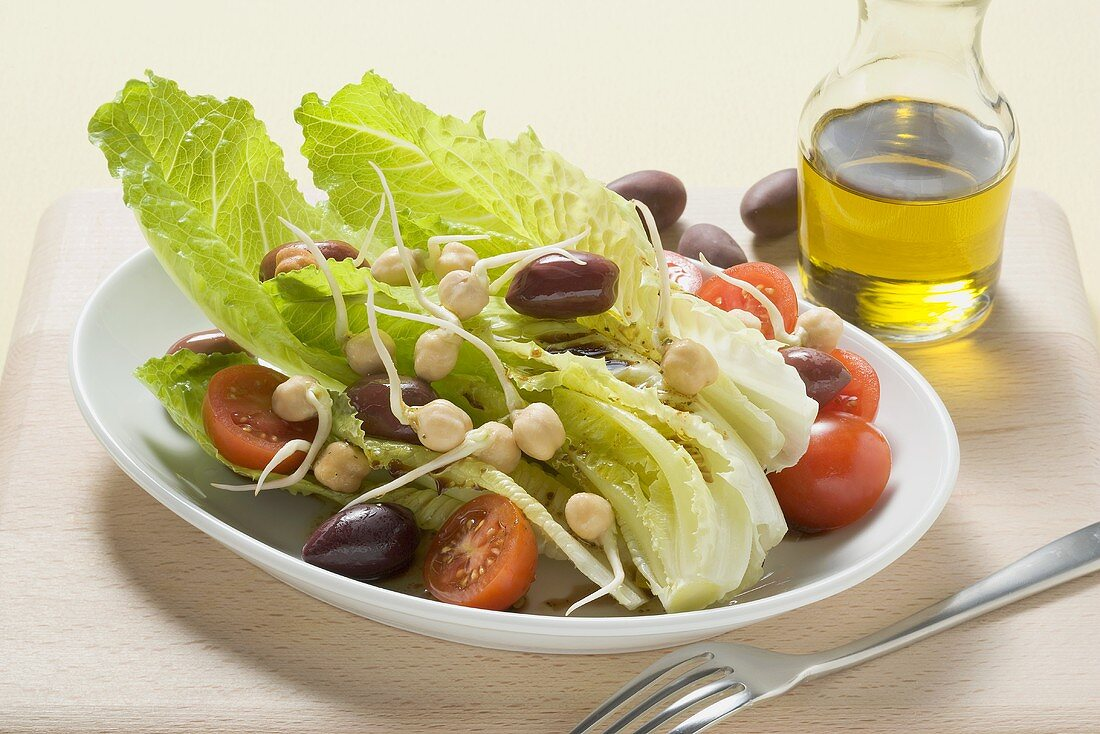 Romaine lettuce with olives and chick-pea sprouts