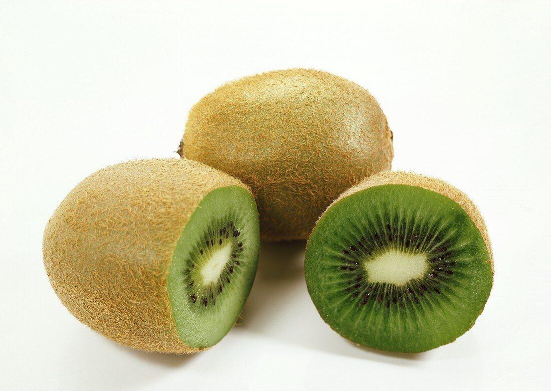 Whole and sliced kiwi fruit