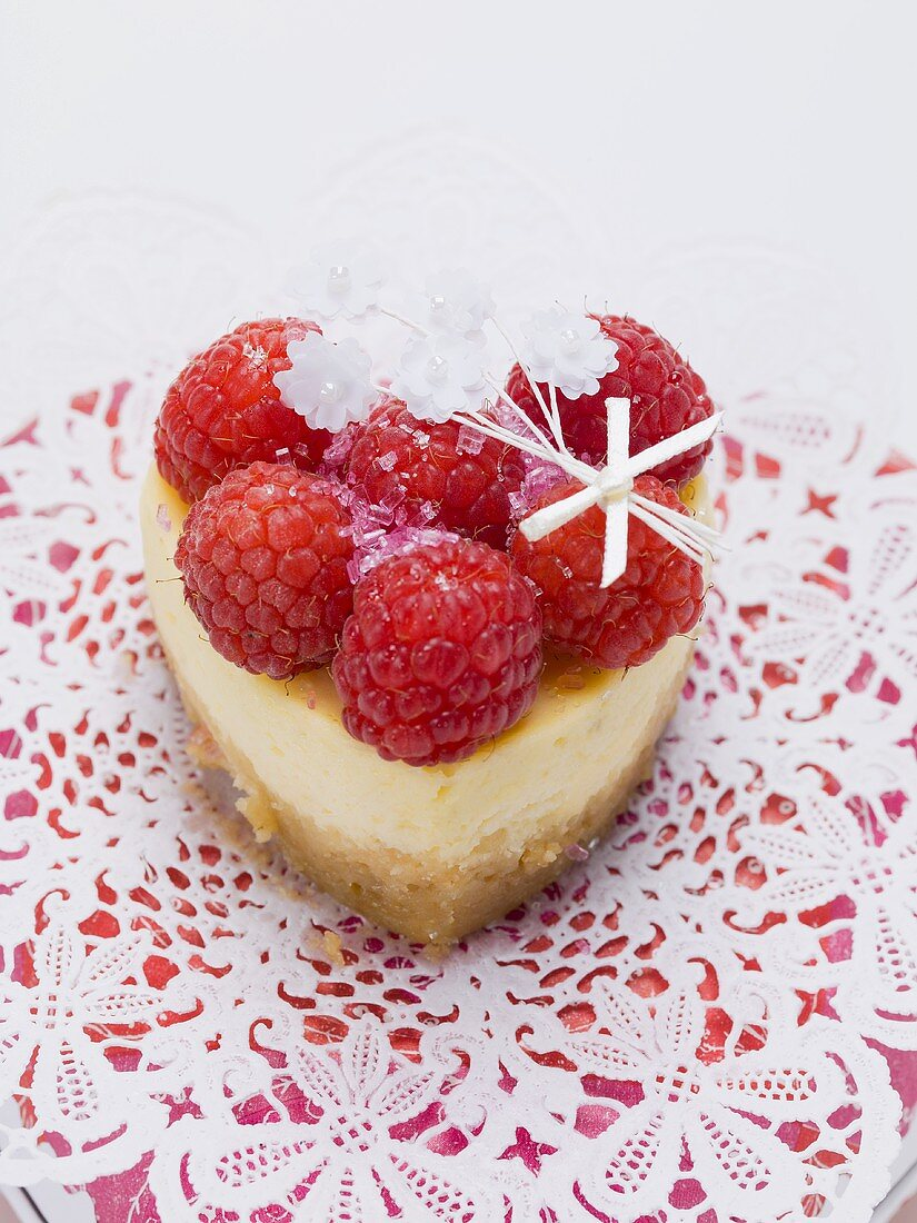Heart-shaped quark cake with raspberries