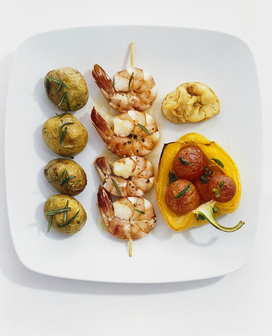 Prawn skewer with rosemary potatoes and grilled vegetables