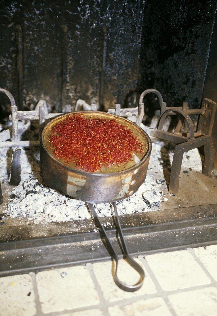 Saffron being dried over charcoal (Abruzzo, Italy)