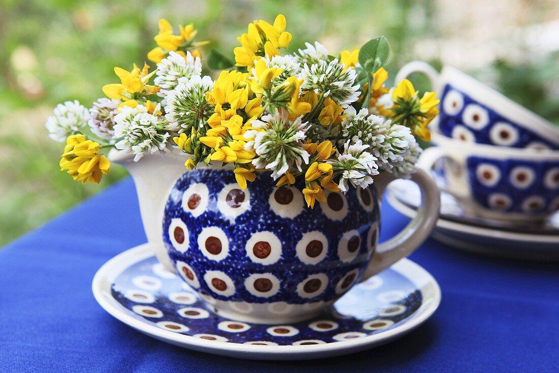 Clover flowers in a milk jug