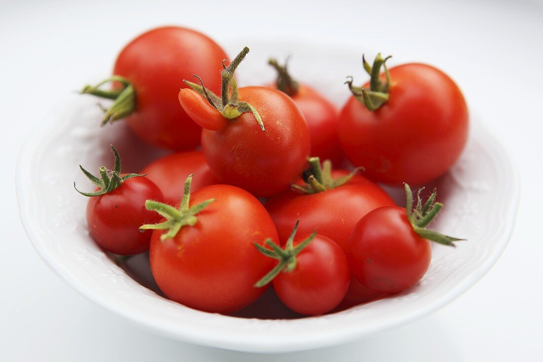 A plate of tomatoes, one deformed