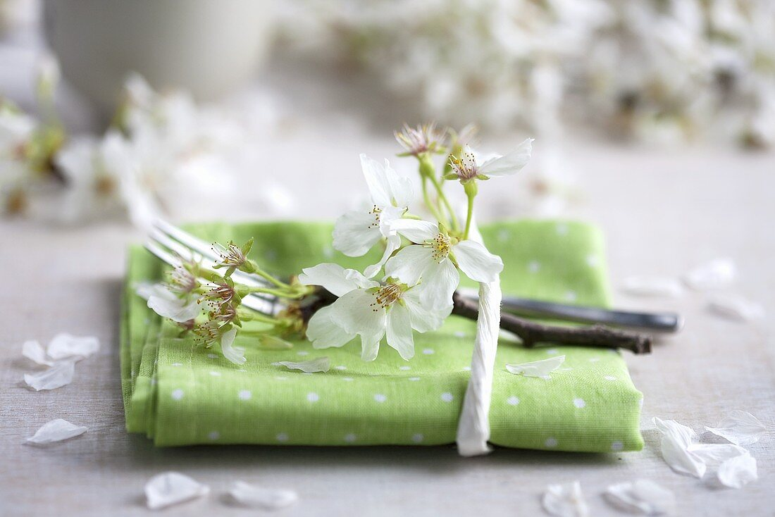 A napkin decorated with a sprig of cherry blossom