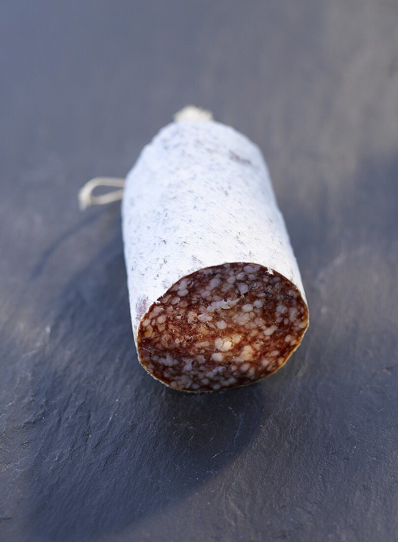 Salami on a stone surface