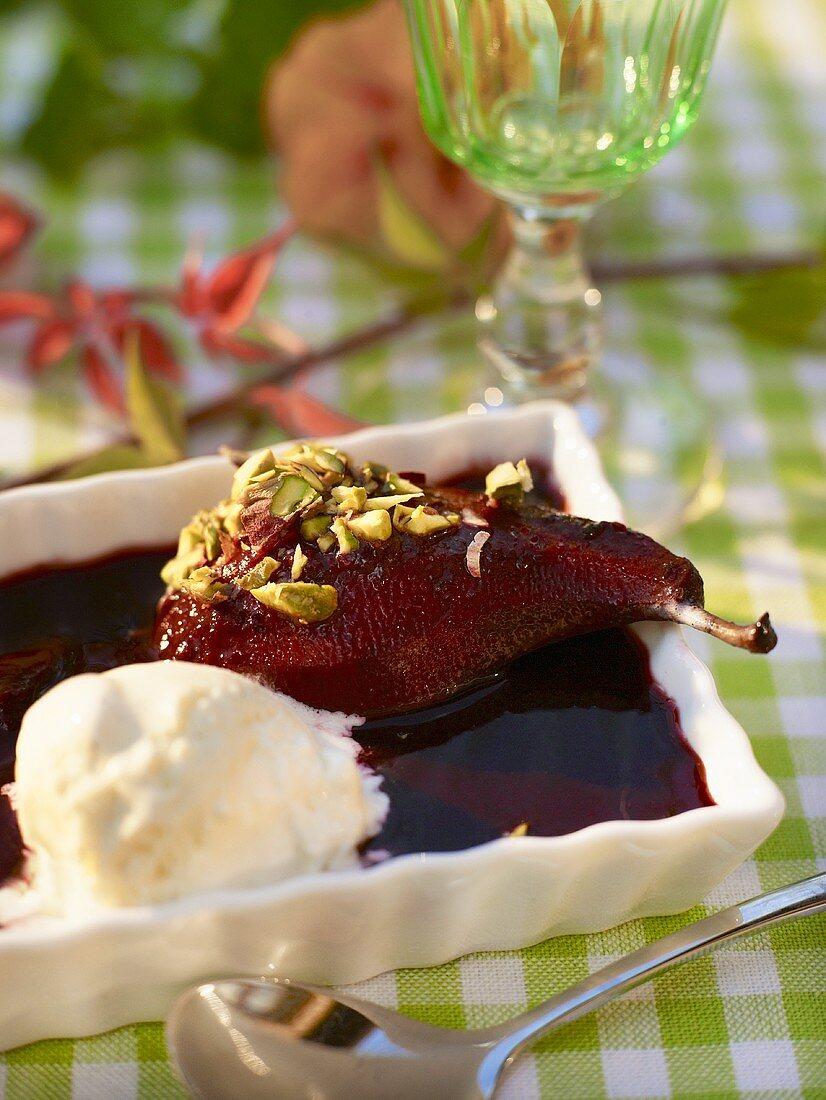 Pear with blackberry sauce and vanilla ice cream