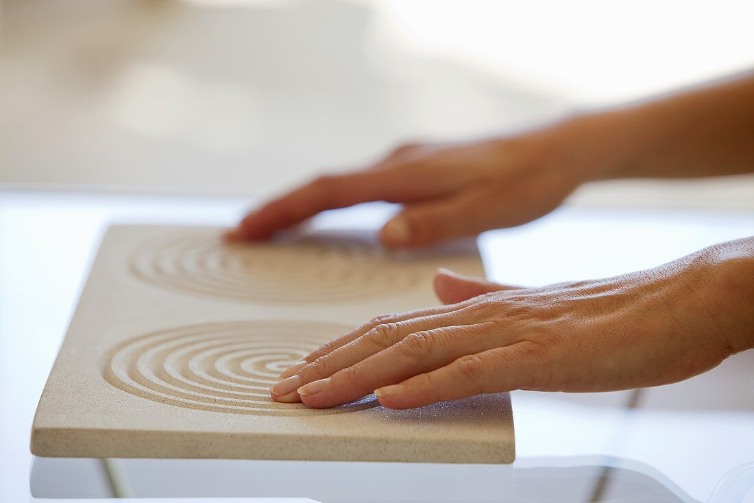 Female hands tracing the lines of a finger maze