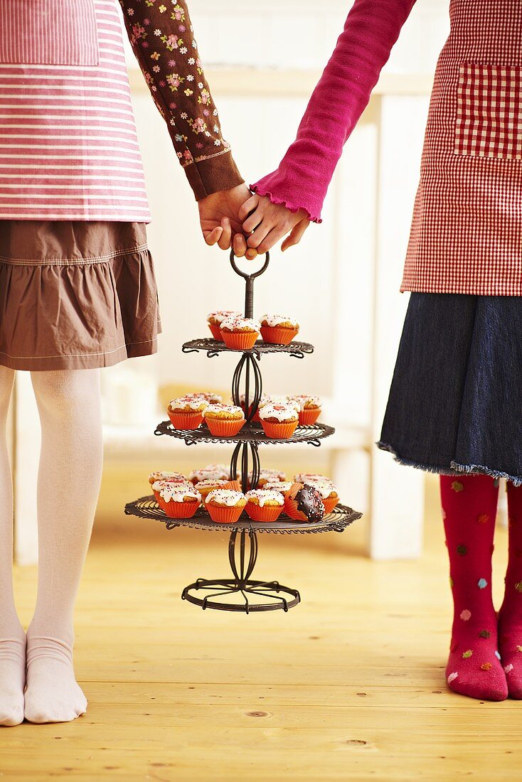 Children holding a cake stand with advent cupcakes