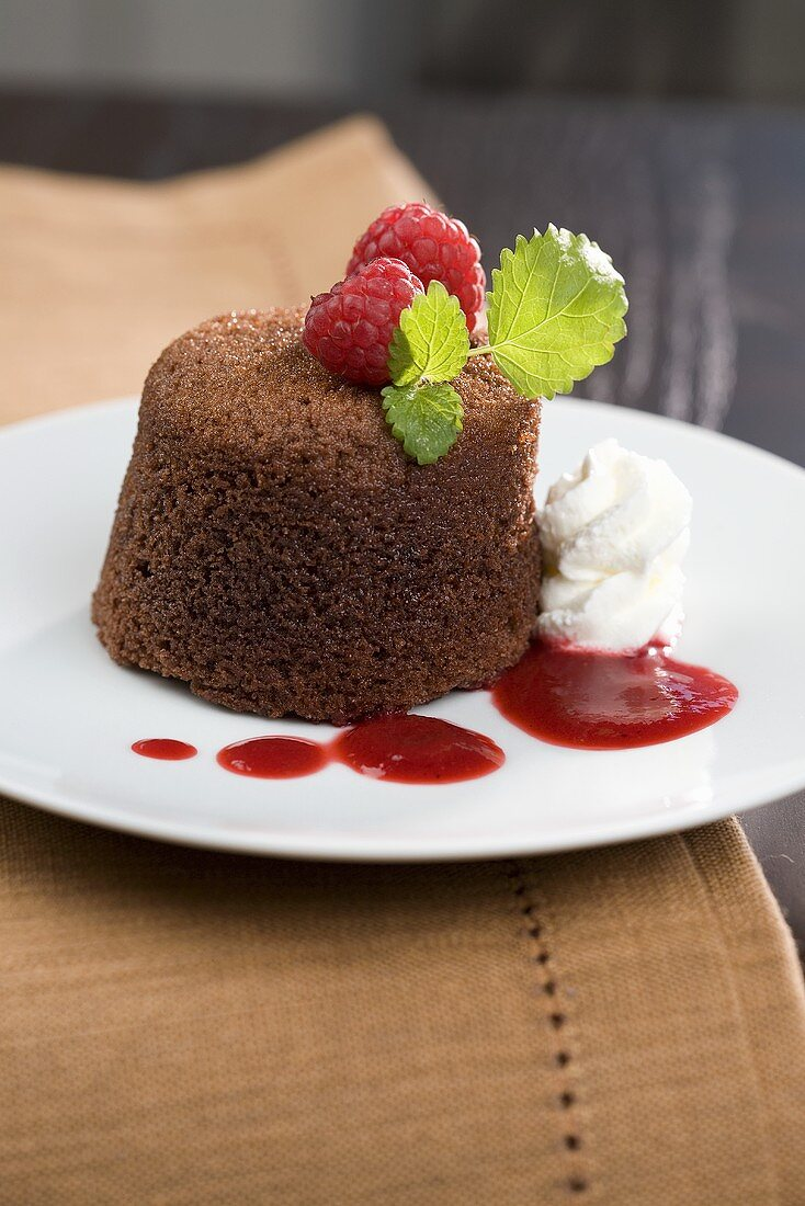 Chocolate souffle with mint and raspberry sauce