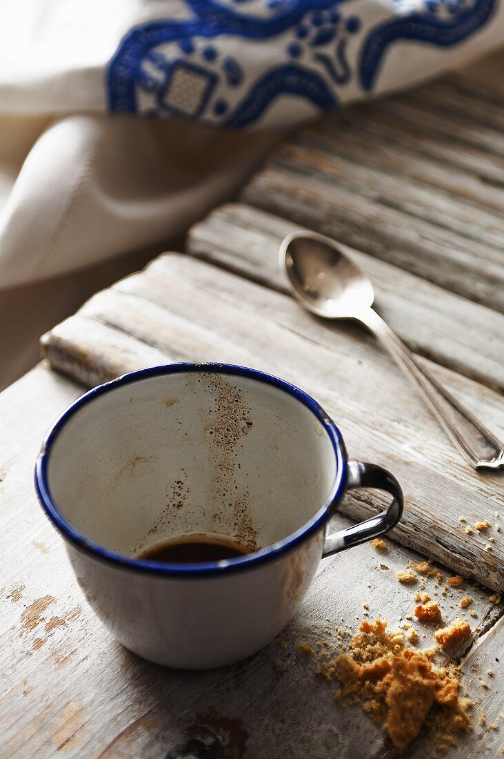 Coffee substitute in an enamel cup with cake crumbs