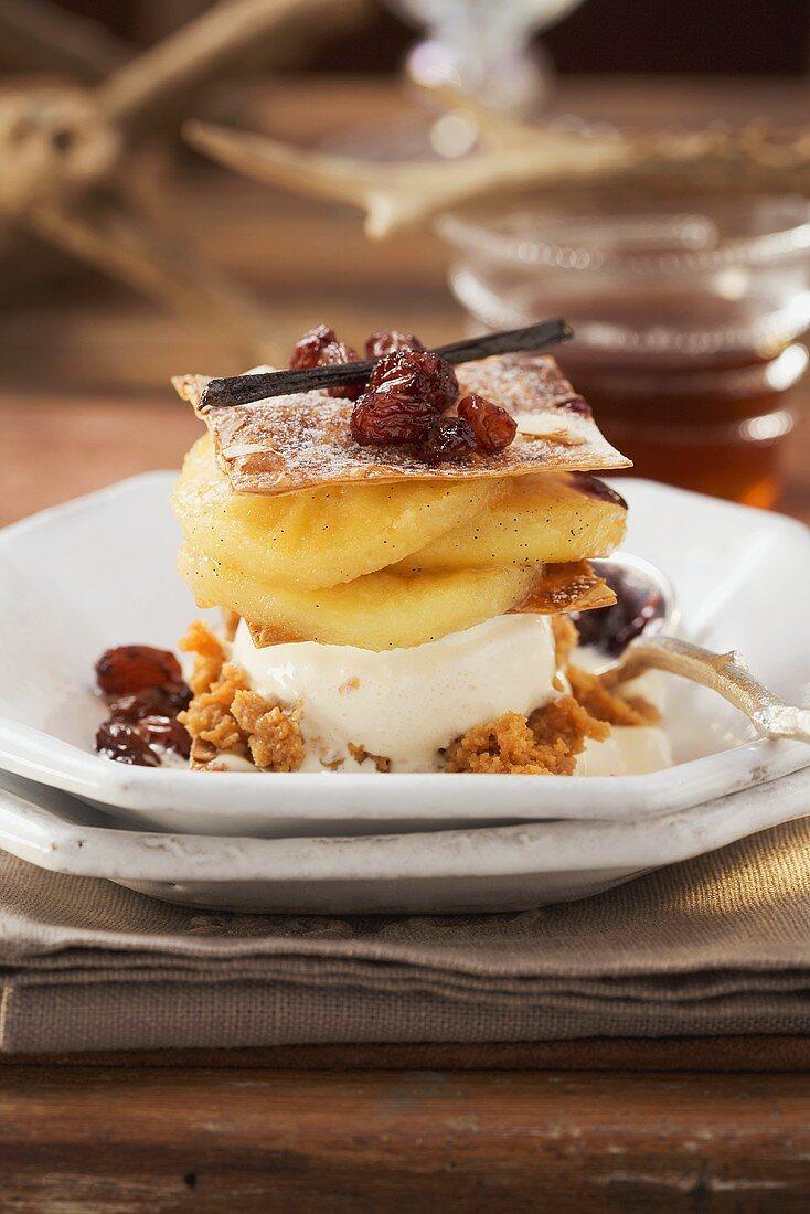 Layered strudel with vanilla ice cream, apples and raisins