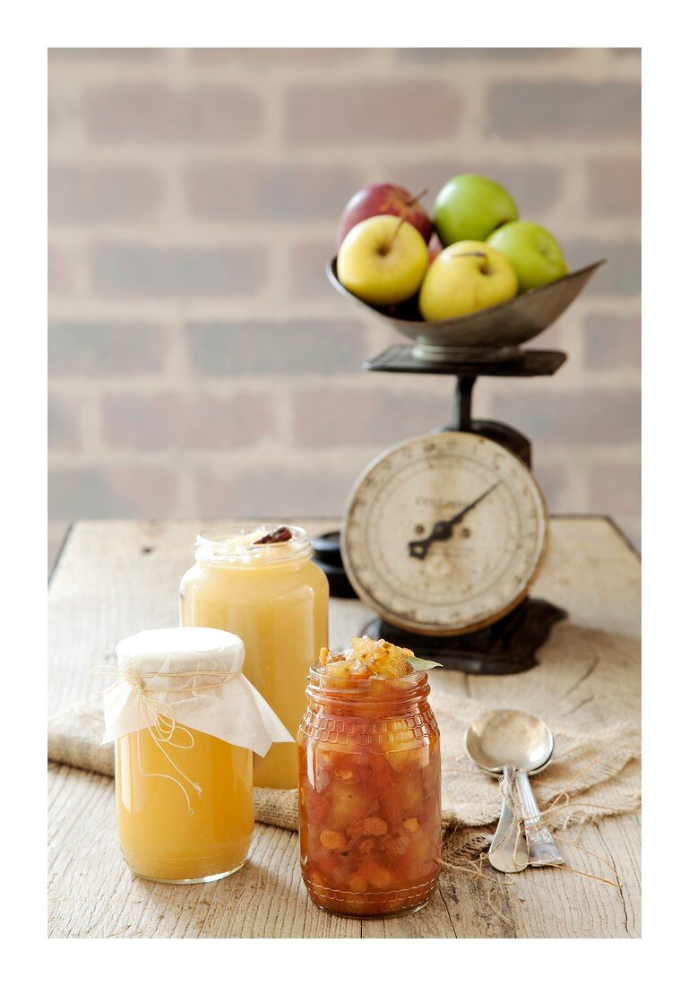 Apply chutney and apple sauce with an old scale in the background with apples on it