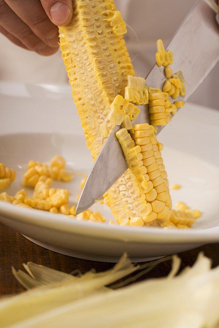 Corn being scraped of a cob
