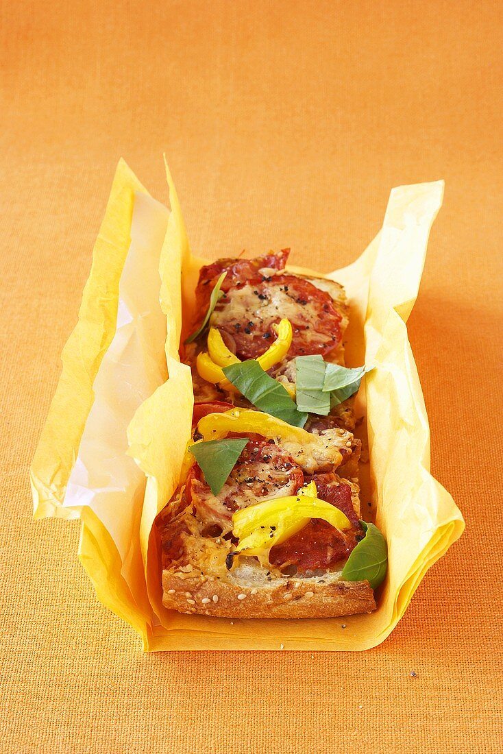 Salami and peppers on flatbread, pizza-style