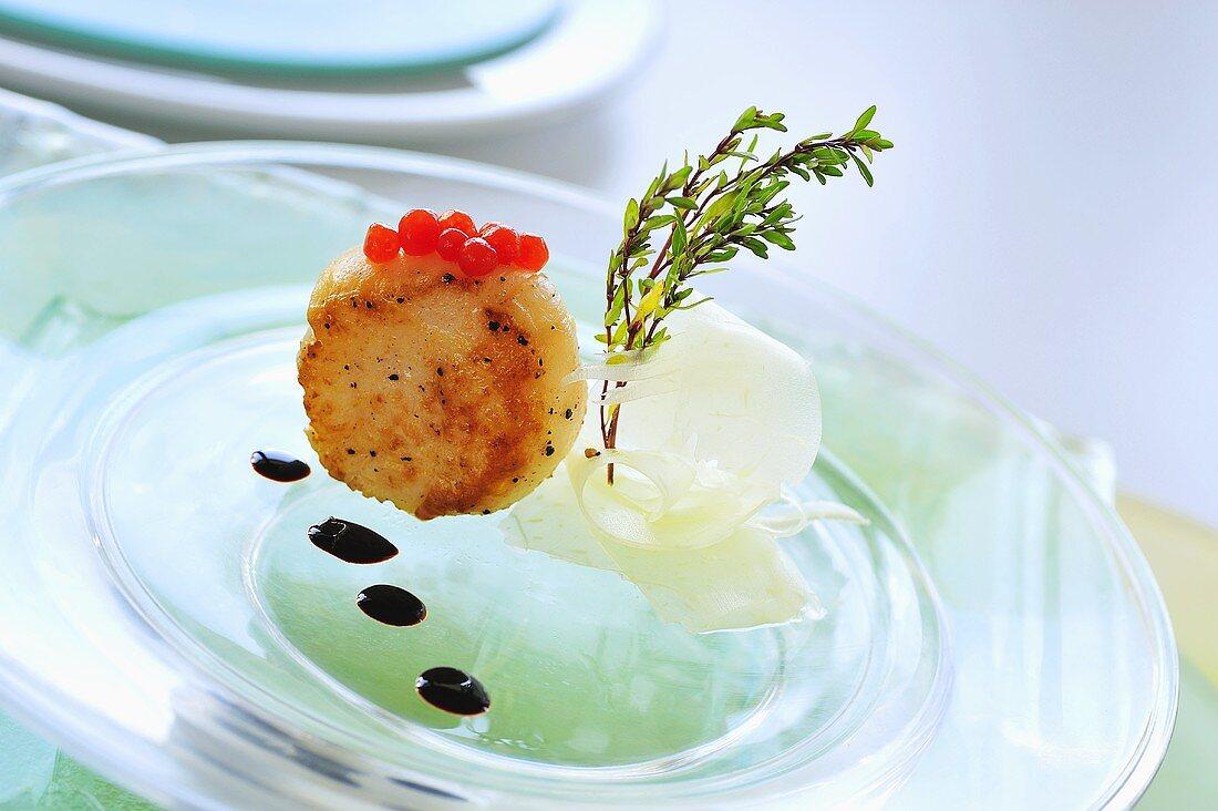 Fried scallop with keta caviar and balsamic vinegar