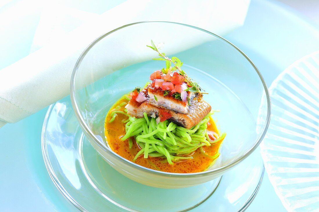 Laksa with green tea noodles, marinated eel and tomato salsa