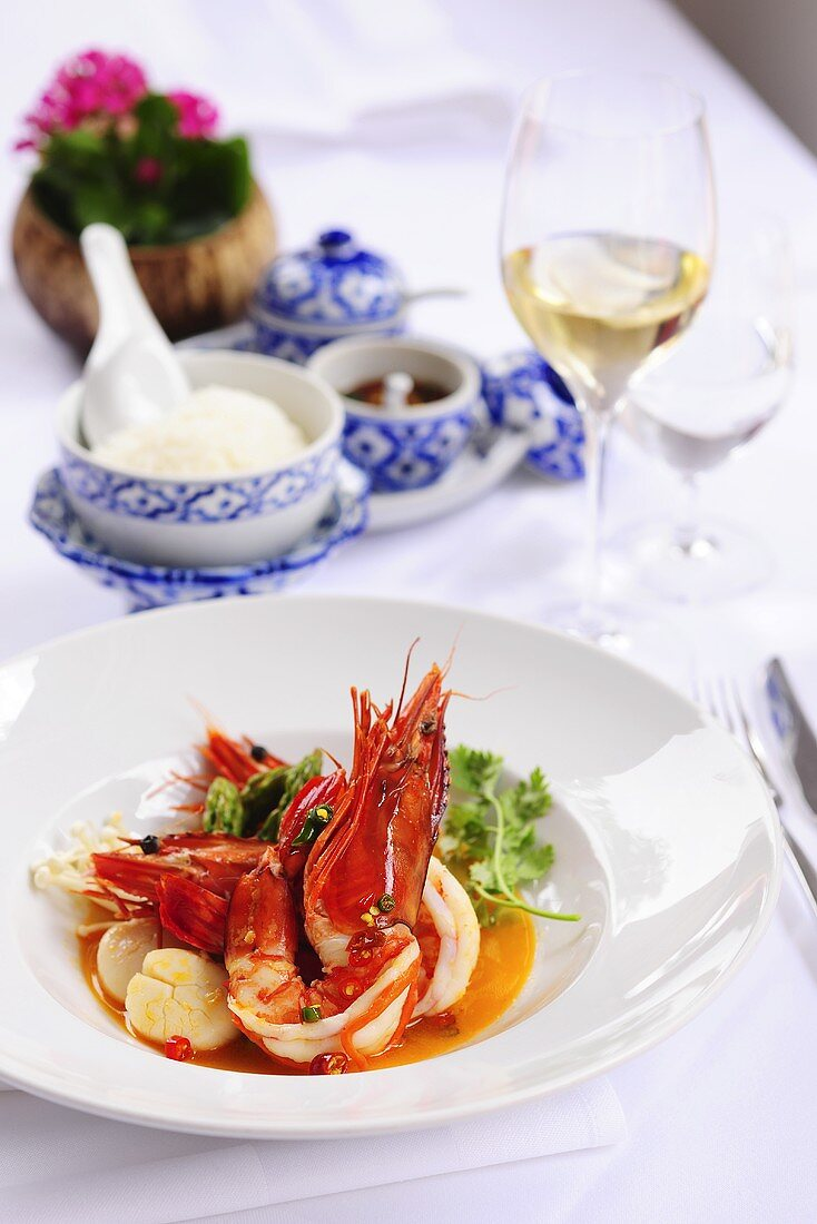 Prawns and scallops in red coconut curry sauce