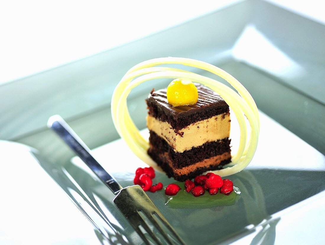 Rum chocolate cake with mango and redcurrants