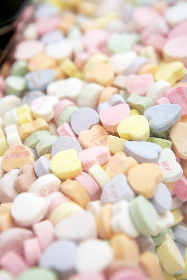 Mixed sugar hearts in a sweet dispenser