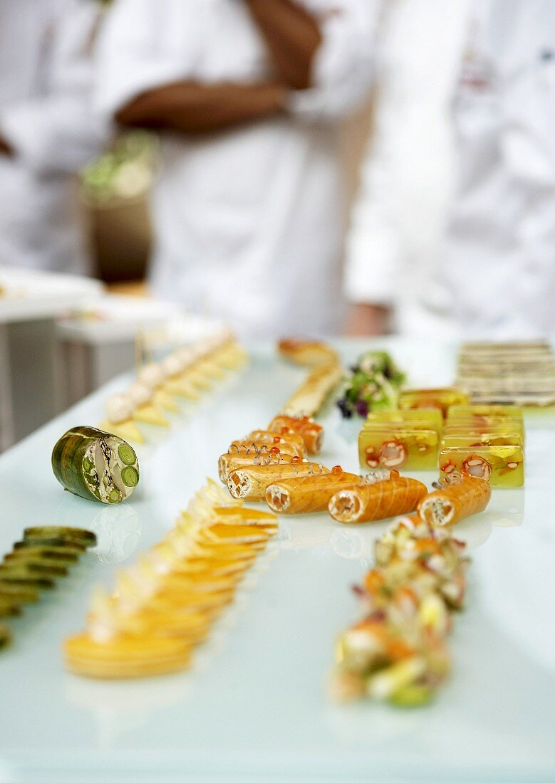 Assorted hors d'oeuvres on a glass slab