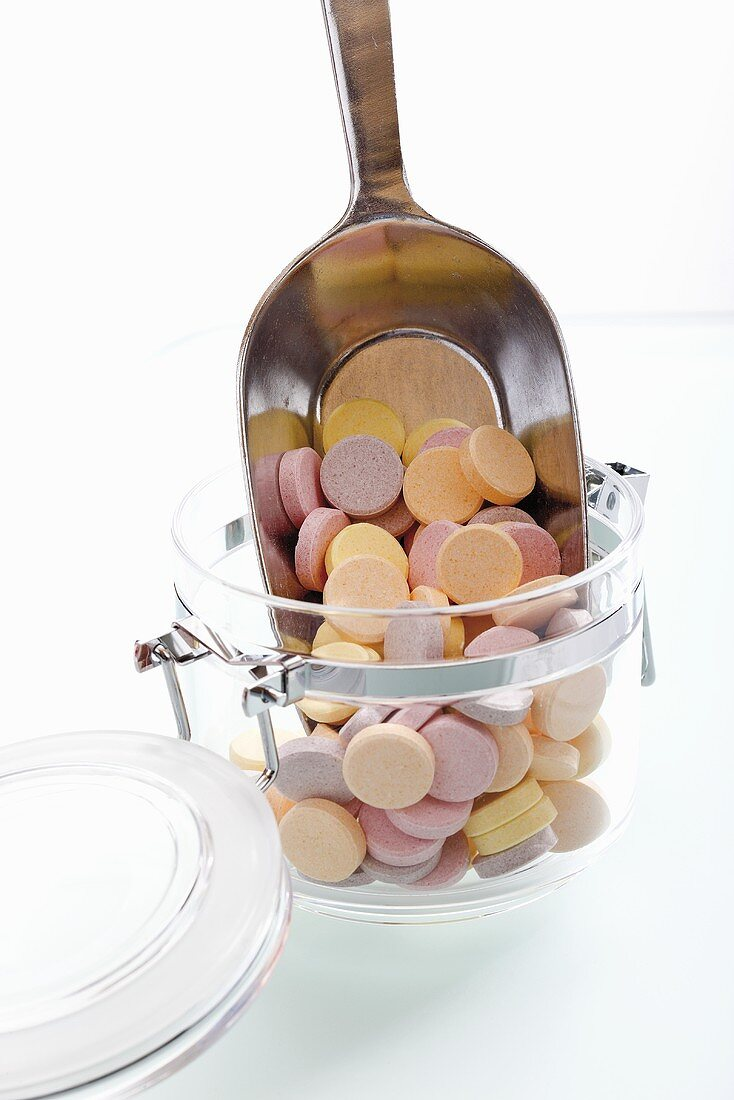 Glucose tabets in storage jar with scoop